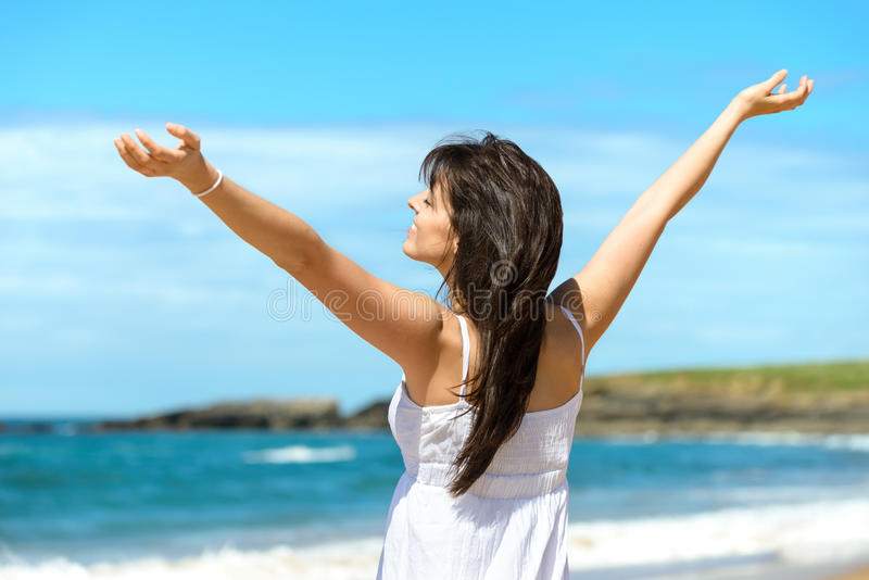 Happy woman on beach stock images