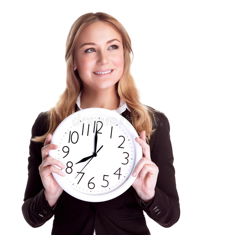 Happy woman with big clock. Portrait of happy smiling business woman holding in hands big clock isolated on white background, regular schedule, success concept royalty free stock photo