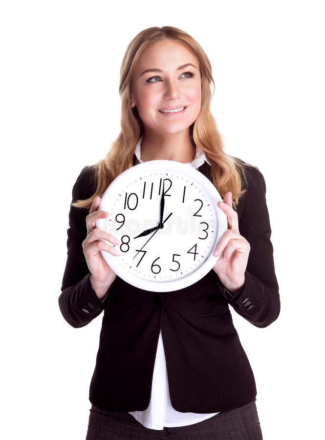 Happy woman with big clock. Portrait of happy smiling business woman holding in hands big clock isolated on white background, regular schedule, success concept stock photography