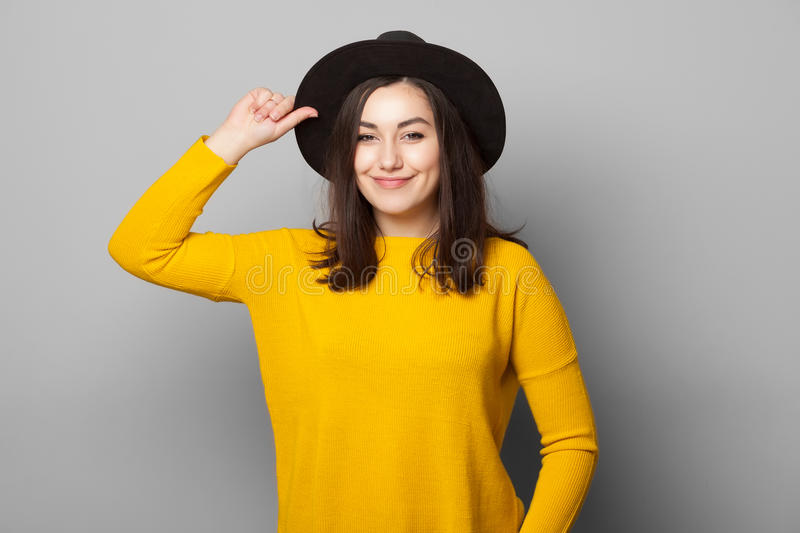 Happy woman with black hat. royalty free stock image