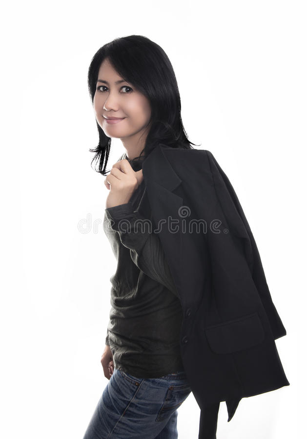 Happy woman in black shirt, jacket and blue jean. royalty free stock image