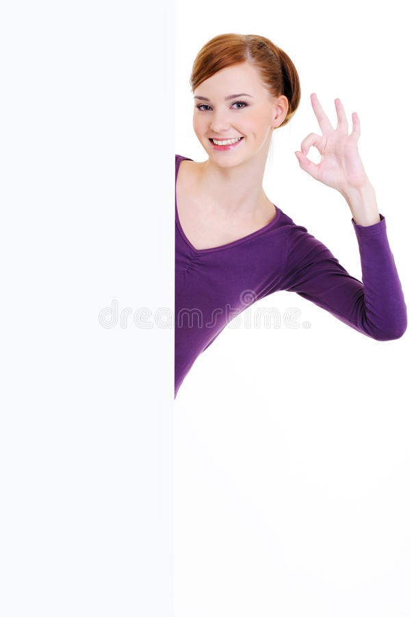 Happy Woman And  Blank  Banner With Okay Gesture Royalty Free Stock Photography