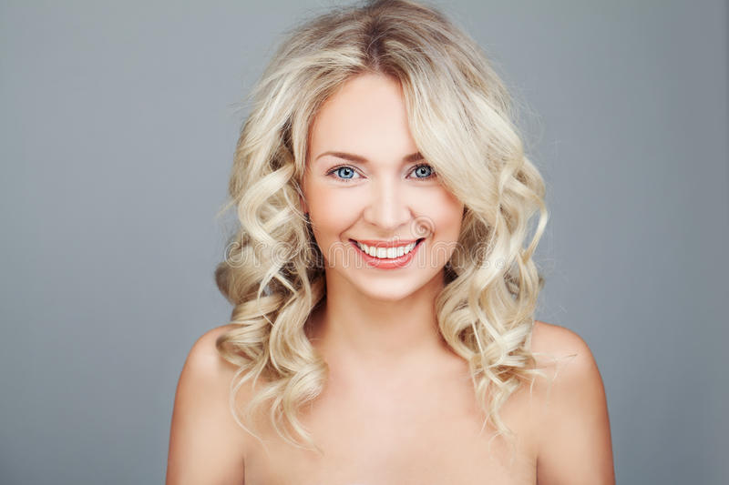 Happy Woman with Blonde Curly Hair royalty free stock photo