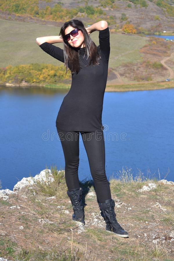 Happy Woman on a Blue Lake Background royalty free stock images