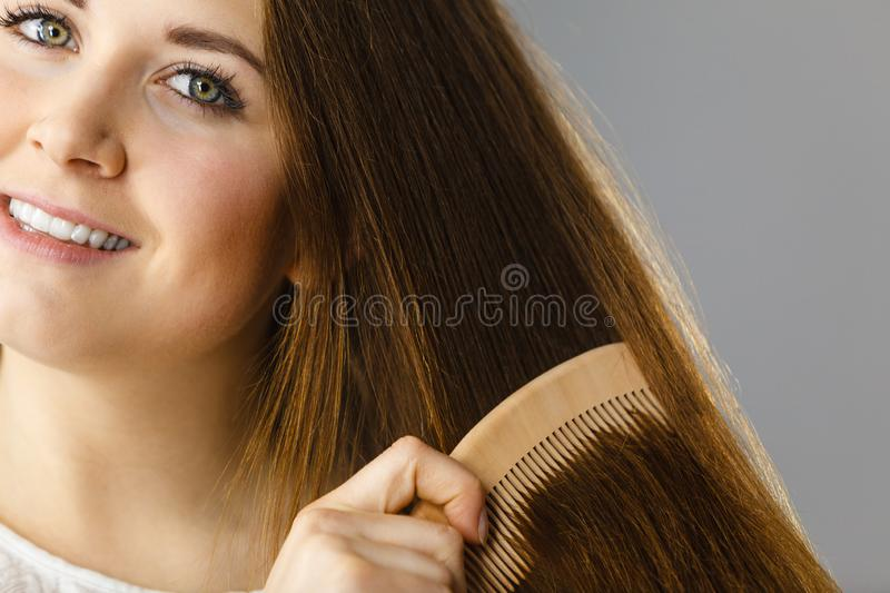 Happy woman brushing her hair royalty free stock photography