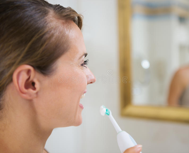 Download Happy Woman Brushing Teeth With Toothbrush Stock Image - Image of health, lifestyle: 26999963