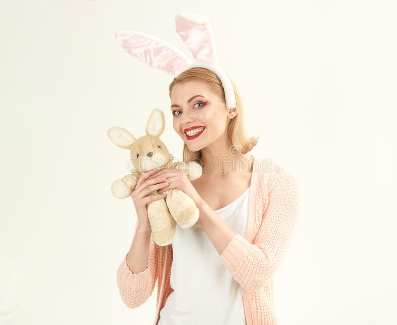 Happy woman in bunny ears with toy. Woman in rabbit bunny ears. Happy easter. Spring holiday. Girl with hare toy. Egg. Hunt. Easter eggs as traditional food royalty free stock photography