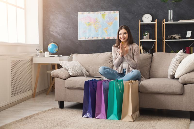 Happy woman buying online with laptop and credit card royalty free stock image