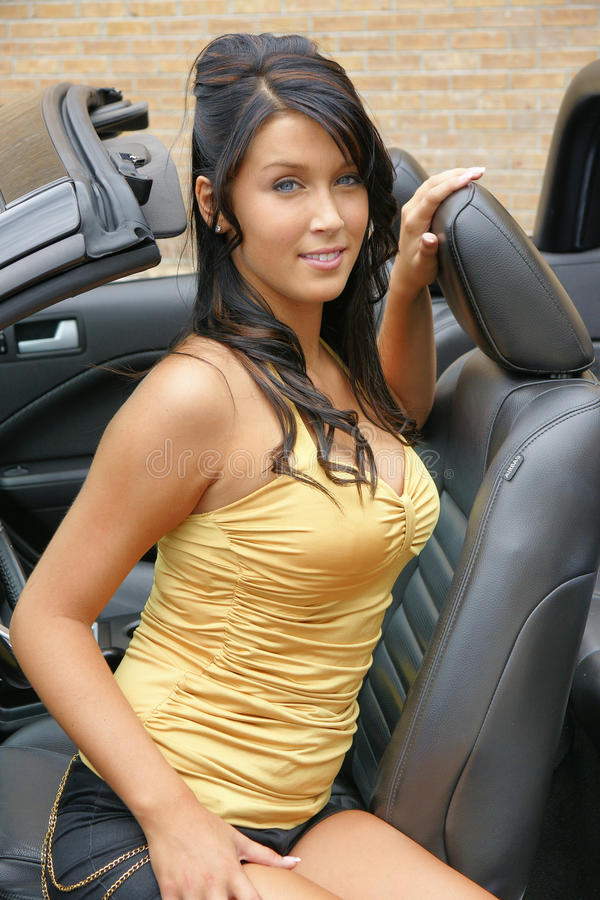 Happy woman in car stock image