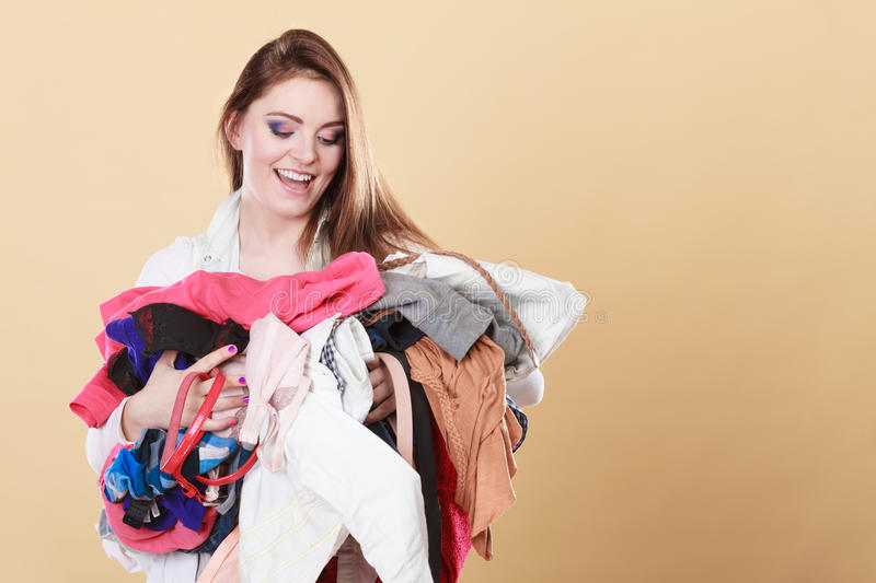 Happy woman carrying dirty laundry clothes. stock images