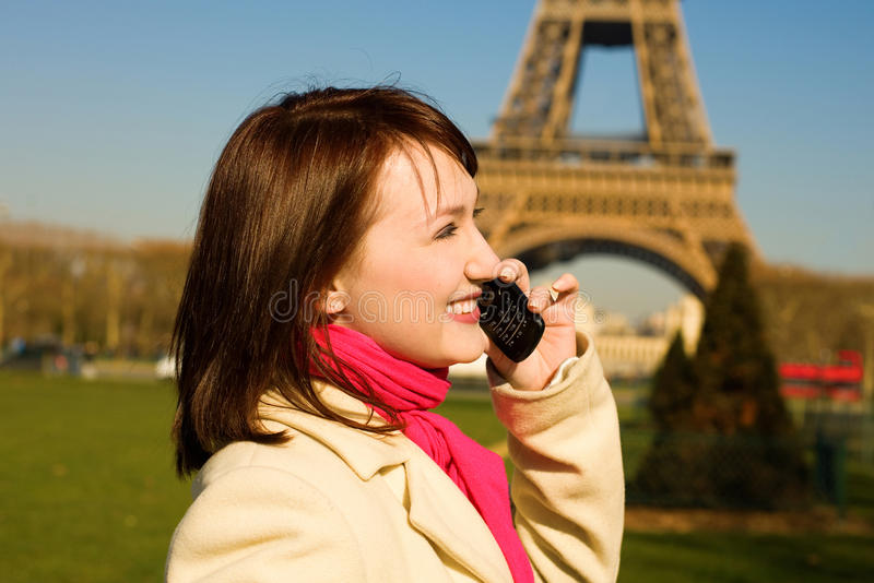 Happy woman with cell phone in Paris stock image