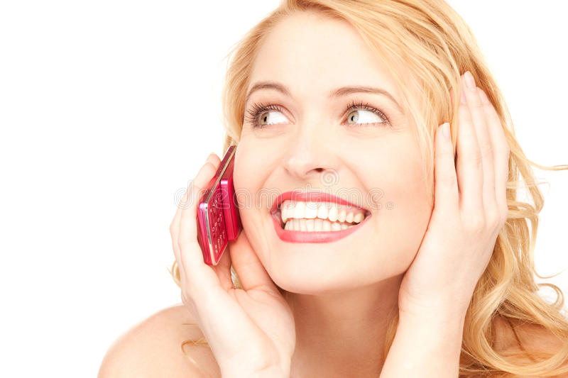 Happy woman with cell phone. Picture of happy woman with cell phone royalty free stock photography
