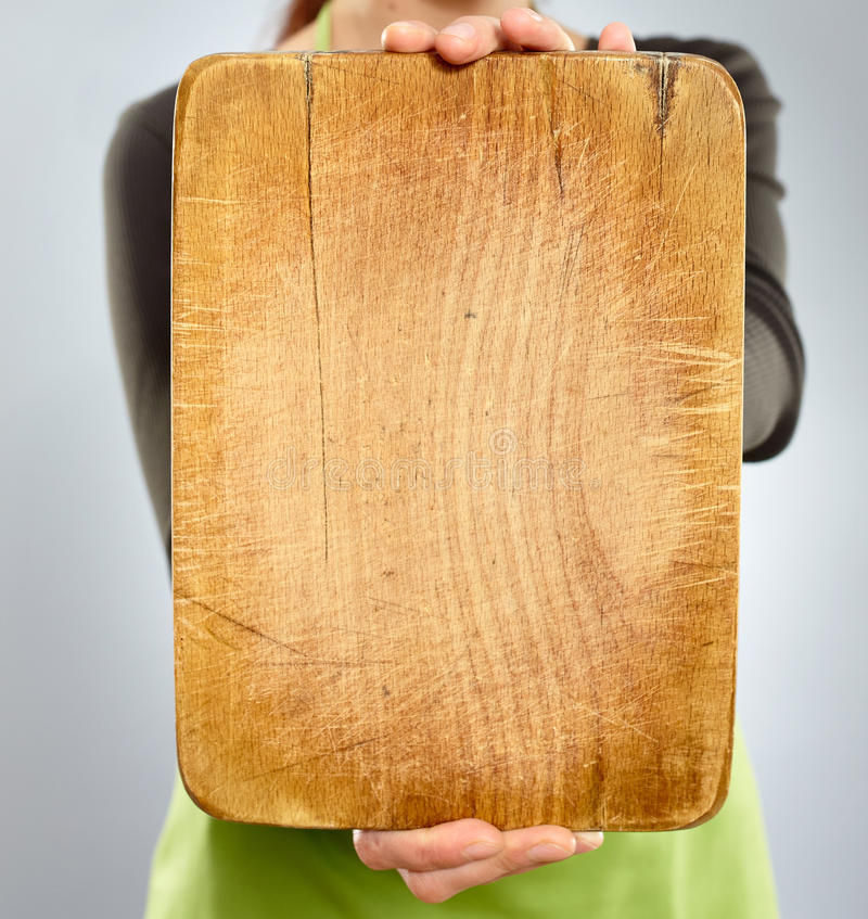 Happy woman chef holding a board stock photos