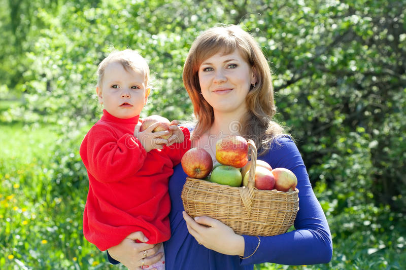 Happy woman and child with apples royalty free stock image