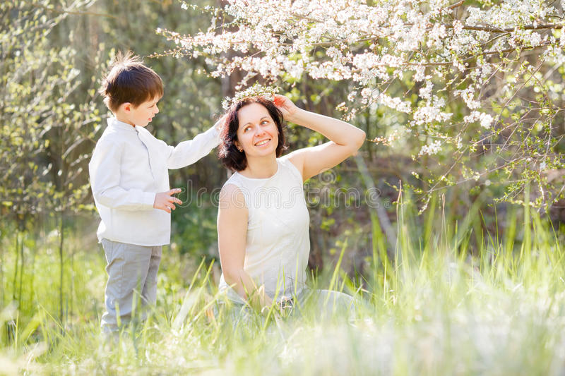 Happy woman and child in the spring garden stock photo
