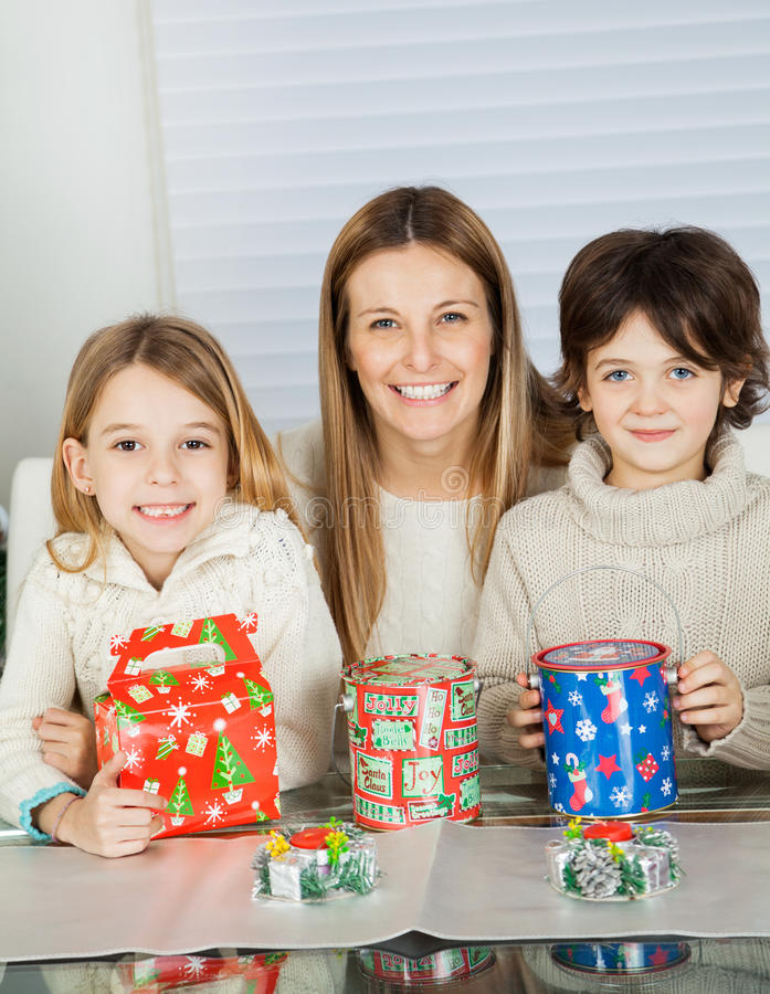 Happy Woman And Children With Christmas Gifts stock photo