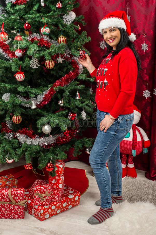 Happy woman with Christmas tree stock photo
