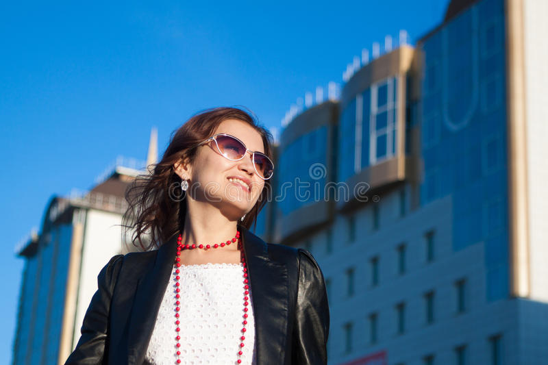 Happy woman on a city street royalty free stock photography
