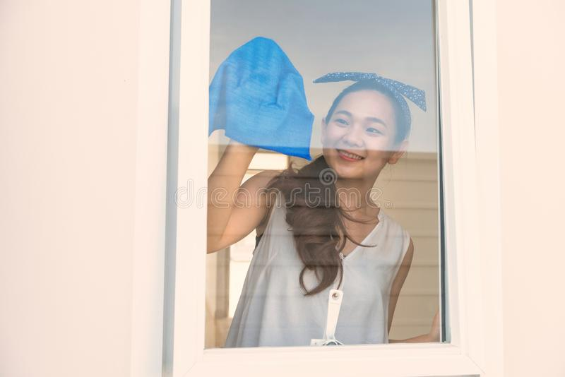 Happy woman clean window of new house royalty free stock photos