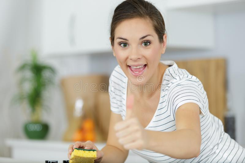 Happy woman cleaning stock photos