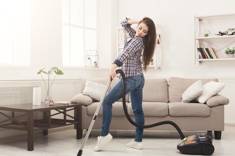 Happy woman cleaning home with vacuum cleaner royalty free stock photos