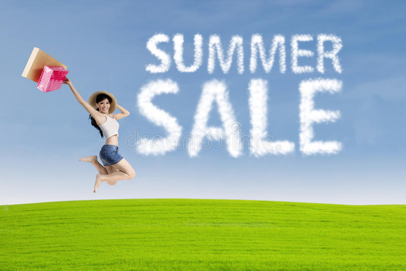 Happy woman with cloud of summer sale royalty free stock photos