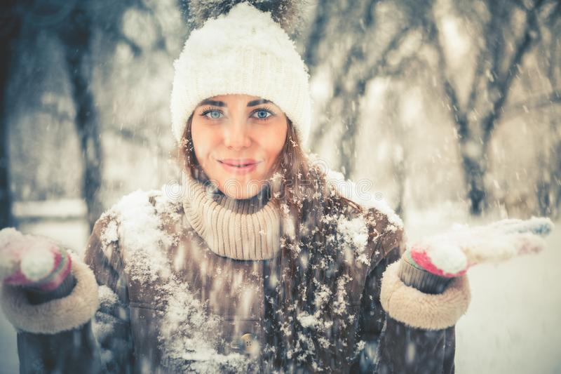 Happy woman at cold snowy winter at New York Park royalty free stock photography