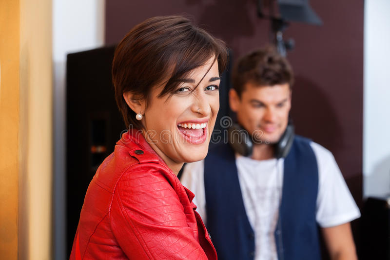Happy Woman With Colleague In Recording Studio stock photo