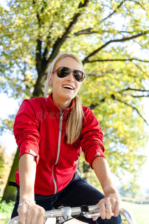 Happy woman cycling on bicycle