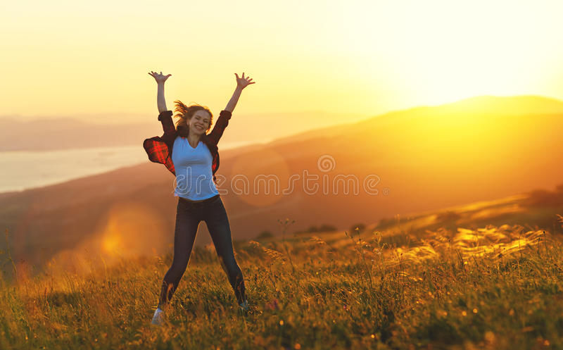 Happy woman dances, jump, rejoices, laughs on sunset in nature. Happy woman with open hands dances, jump, rejoices, laughs on sunset in nature royalty free stock photos