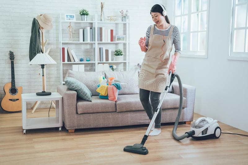Happy woman doing housework enjoy music royalty free stock image