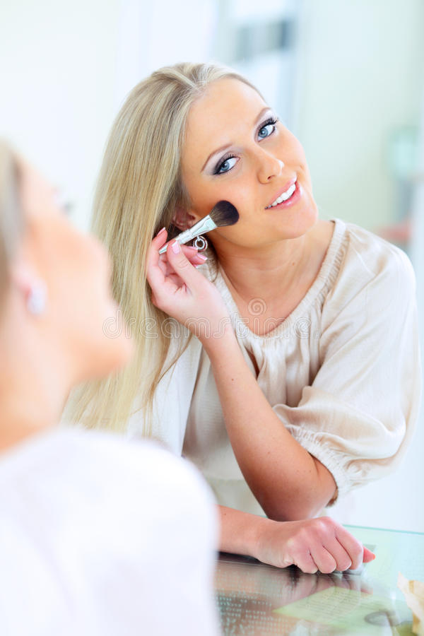 Download Happy woman doing makeup stock photo. Image of interior - 18951734
