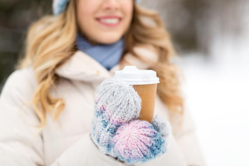 Happy woman drinking coffee outdoors in winter royalty free stock images