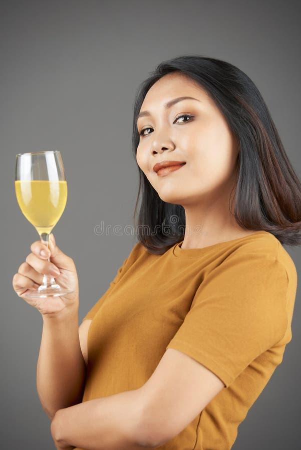 Happy woman drinking pineapple juice royalty free stock photos