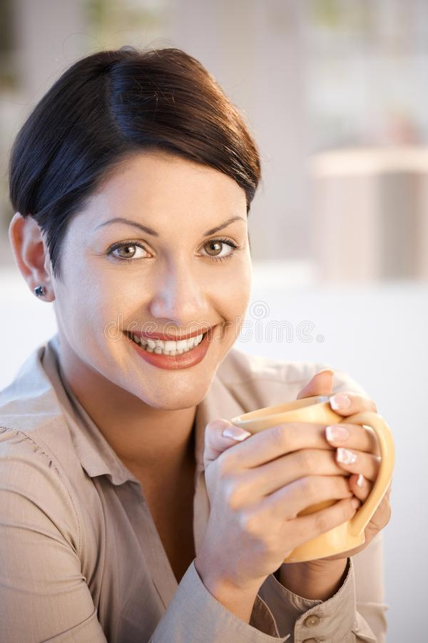 Download Happy woman drinking tea stock photo. Image of female - 16808408
