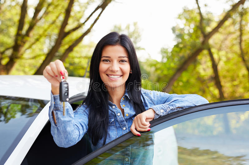 Happy woman driver with car keys royalty free stock image