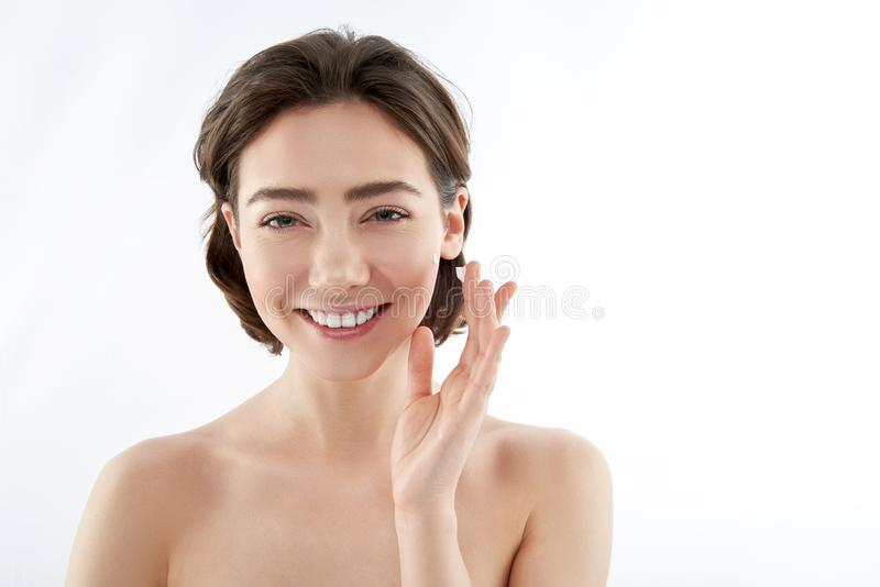 Happy woman with drop of cream on finger royalty free stock photography