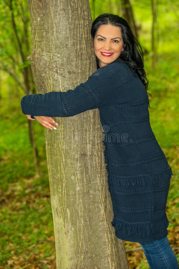 Happy woman embrace tree. Happy woman embrace a tree in the forest stock photos