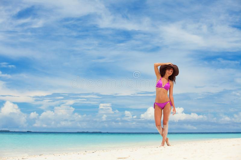 Happy woman enjoy the beach. White sand, crystal-blue sea of tropical beach. Vacation at Paradise. Happy island lifestyle. Ocean royalty free stock photos
