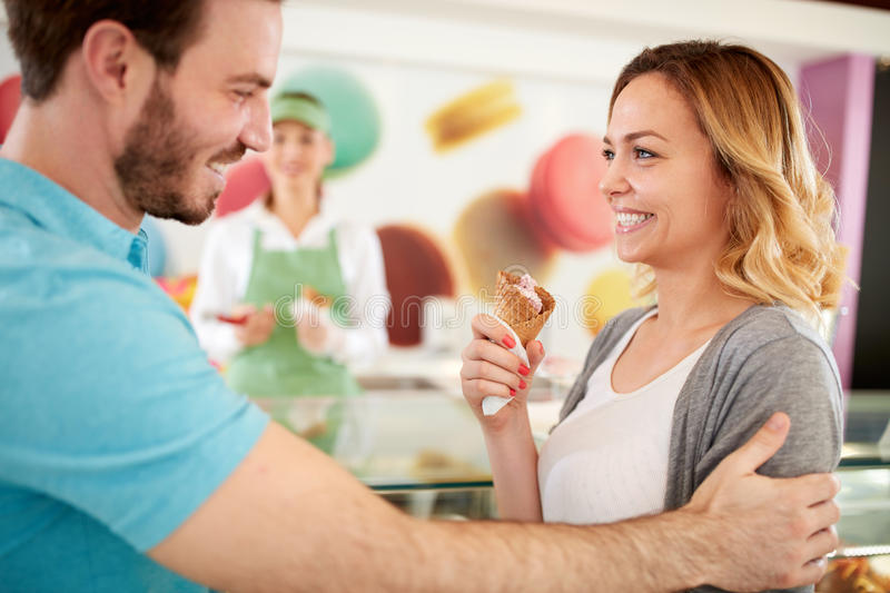 Happy woman enjoy in ice cream in confectionery stock photo