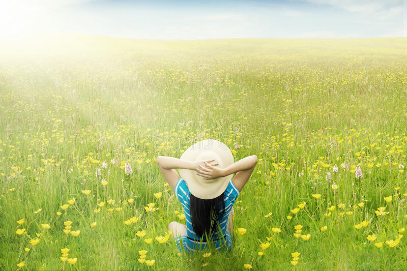 Happy woman enjoy springtime on meadow royalty free stock image