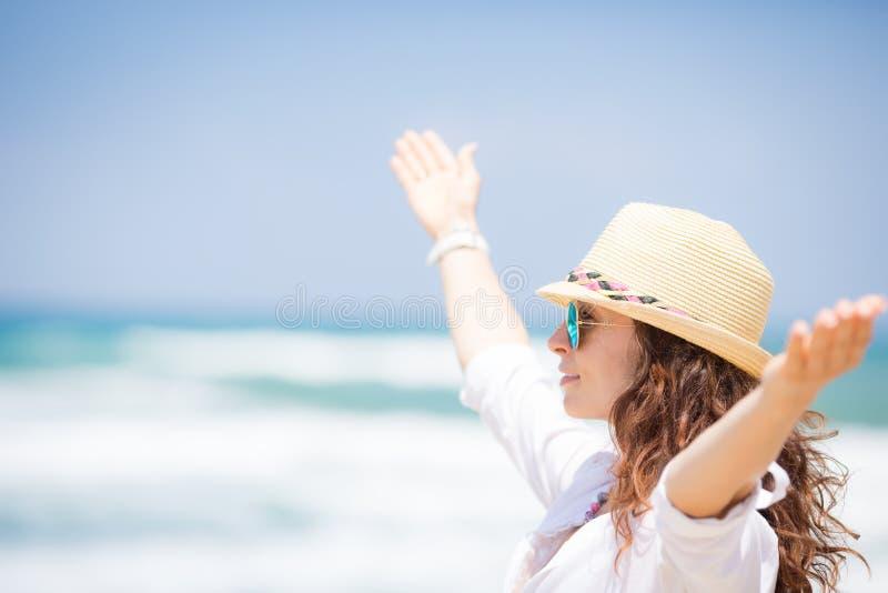 Happy woman enjoying at the beach royalty free stock photo