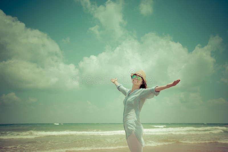 Happy woman enjoying at the beach royalty free stock photography
