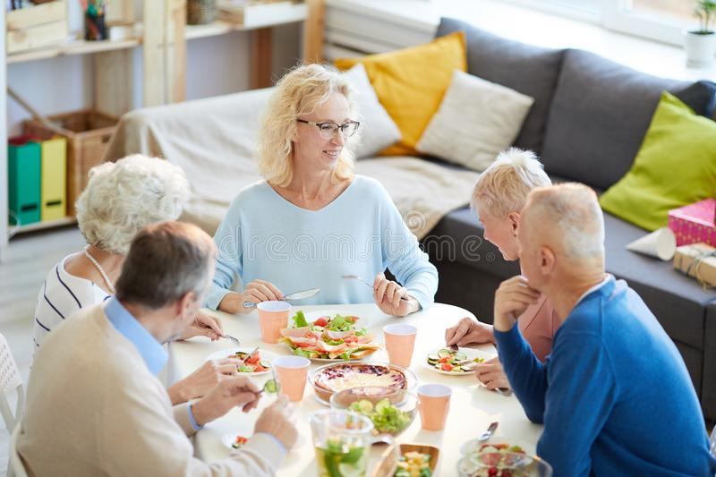 Happy woman enjoying dinner with friends stock photo