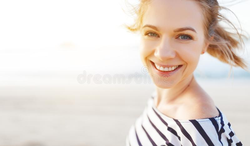 Happy woman enjoying freedom and laughs on sea. Happy young woman enjoying freedom and laughs on sea royalty free stock photo