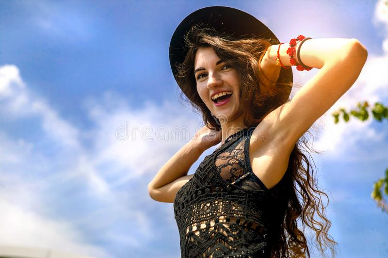 Happy woman enjoying freedom outdoor on sky background. royalty free stock photography