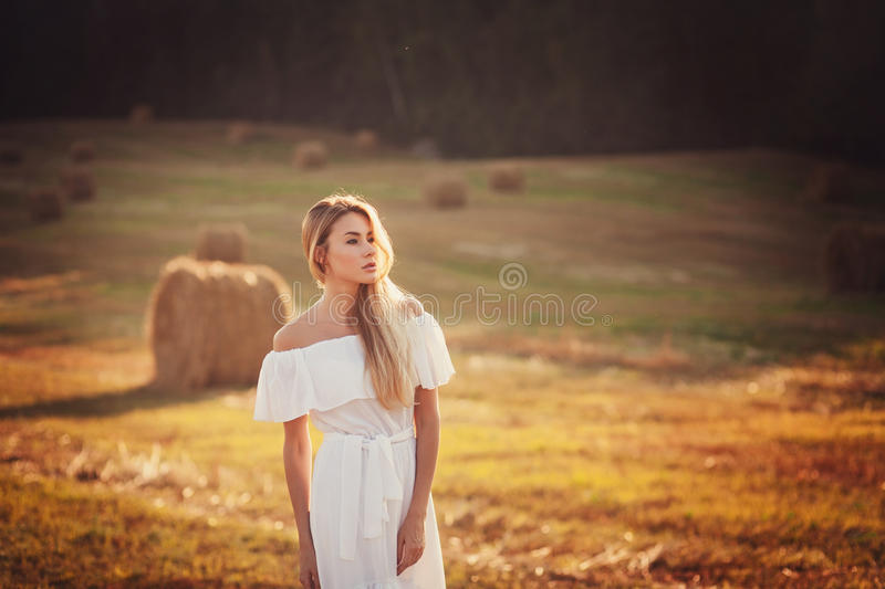 Happy Woman. Enjoying Nature in field royalty free stock photo
