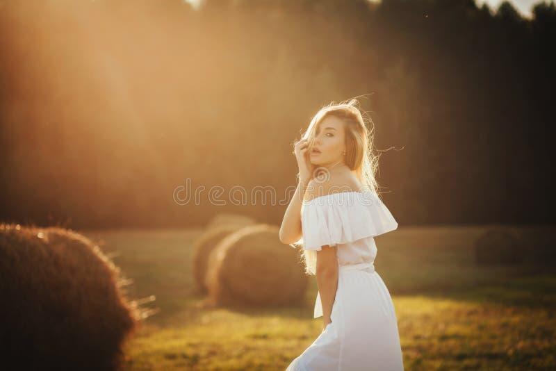 Happy Woman. Enjoying Nature on sunset royalty free stock photo