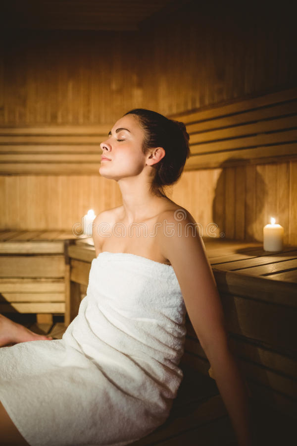 Happy woman enjoying the sauna royalty free stock photo
