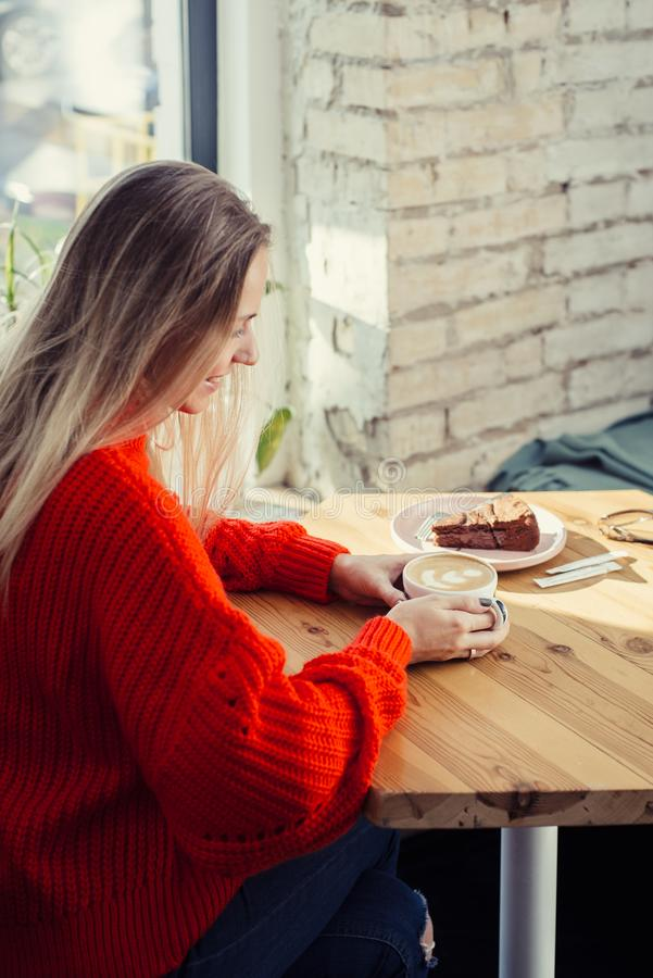 Happy woman enjoying some coffee in a cafeteria royalty free stock photo